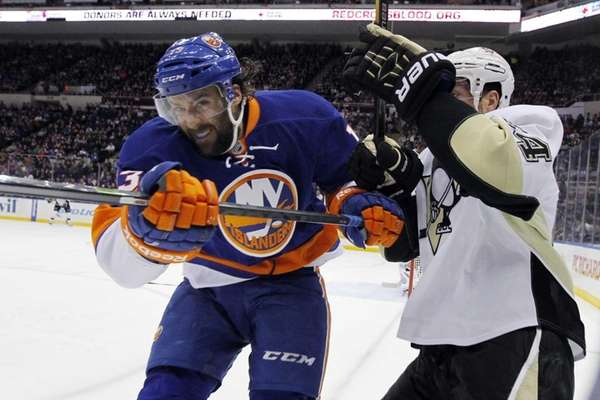 Colin McDonald checks the Pittsburgh Penguins' Brooks Orpik