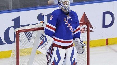Rangers goalie Henrik Lundqvist stands in goal after