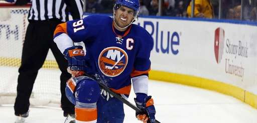 John Tavares of the Islanders grimaces after falling