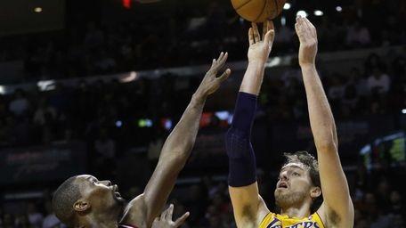 Los Angeles Lakers center Pau Gasol shoots over