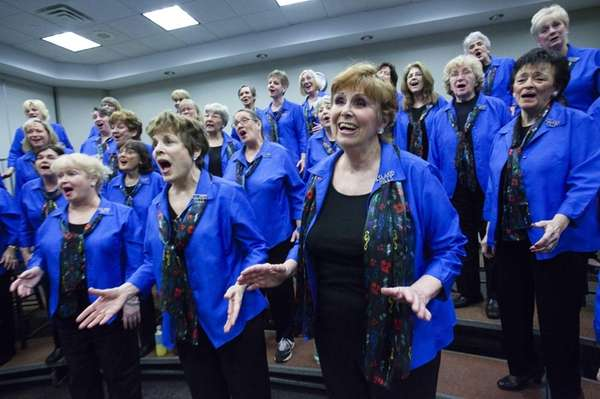 Members of the Island Hills Chorus put heart,