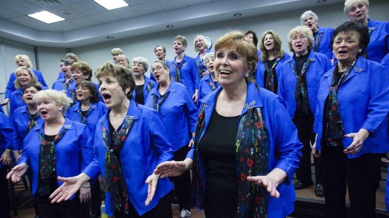 Members of the Island Hills Chorus put heart,
