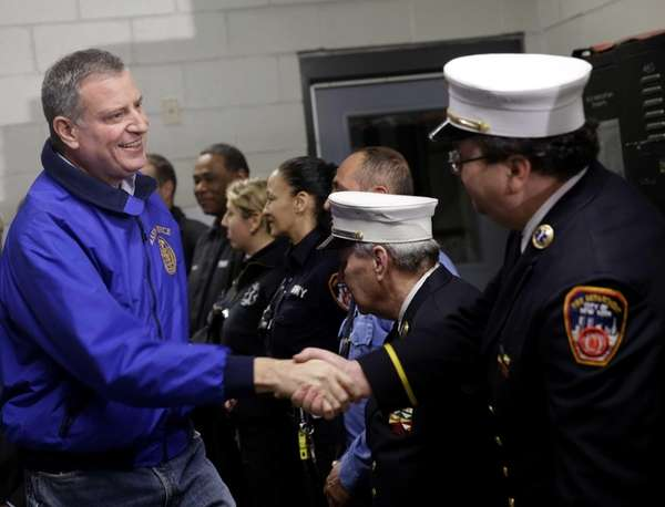 New York City Mayor Bill de Blasio, left,