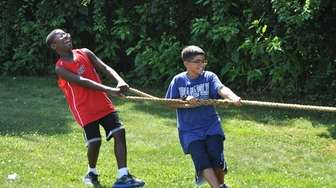 A tug-of-war is part of the fun at