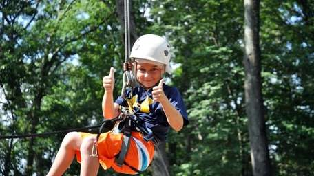 Nicholas Cottage, 7 and from Smithtown, enjoys ziplining