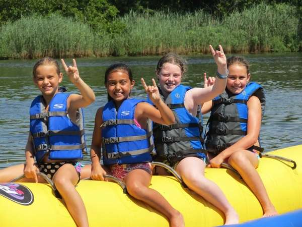 Girls learn kayaking and water safety at Rolling