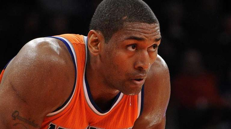 Knicks' Metta World Peace looks on from the