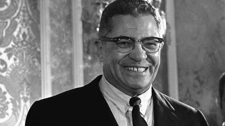 Green Bay Packers head coach Vince Lombardi smiles
