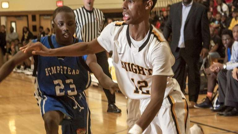 Uniondale's Imran Ritchie drives to the basket around