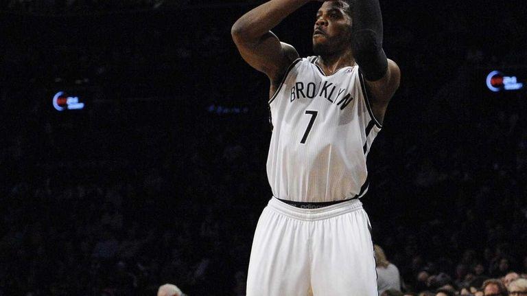 Joe Johnson shoots and scores a three-point basket