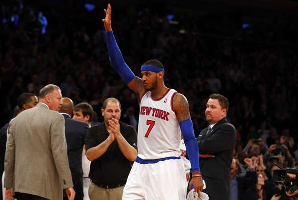 Carmelo Anthony acknowledges the crowd after leaving the