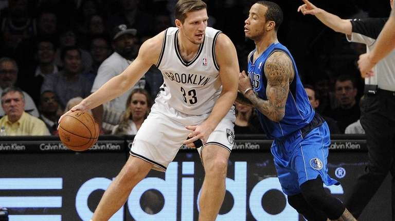 Nets forward Mirza Teletovic drives against Dallas Mavericks