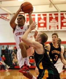 Stony Brook's Carson Puriefoy drives the paint for