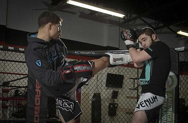 UFC fighter Al Iaquinta of Wantagh, left, trains