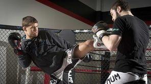 UFC fighter Al Iaquinta of Wantagh, left, trains
