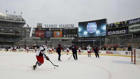 The Rangers practice on the rink at Yankee