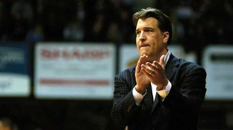 St. John's head coach Steve Lavin watches from