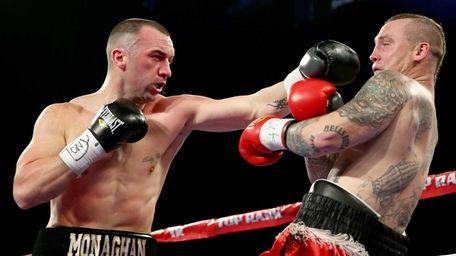Sean Monaghan punches Matthew Vanda during their WBC