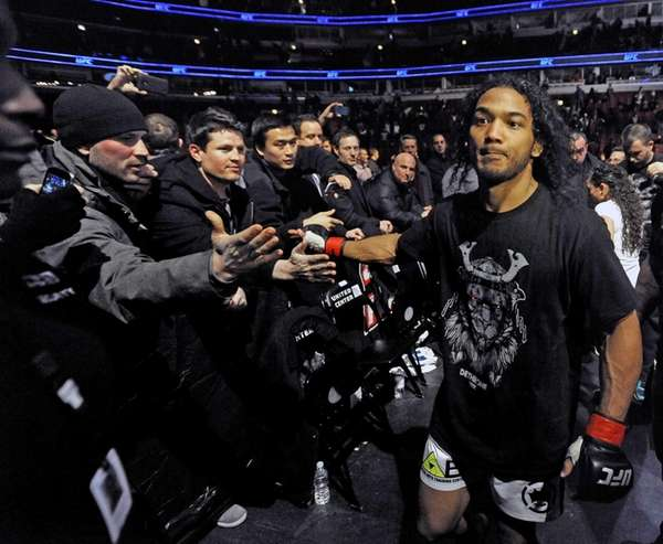 Benson Henderson celebrates with fans after defeating Josh