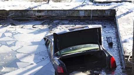 Nassau County police remove a car from the