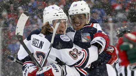 Carl Hagelin celebrates with Marc Staal after scoring