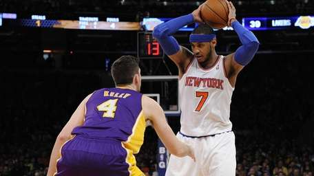 Carmelo Anthony is guarded by Lakers' Ryan Kelly