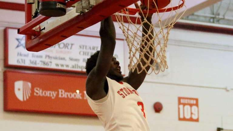 Stony Brook's Ahmad Walker dunks during a game