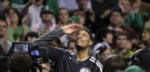 Brooklyn Nets forward Paul Pierce, center, formerly of