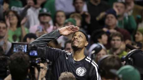 Brooklyn Nets forward Paul Pierce, center, formerly of