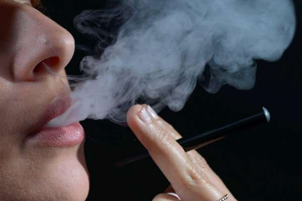 This file image shows a woman smoking a