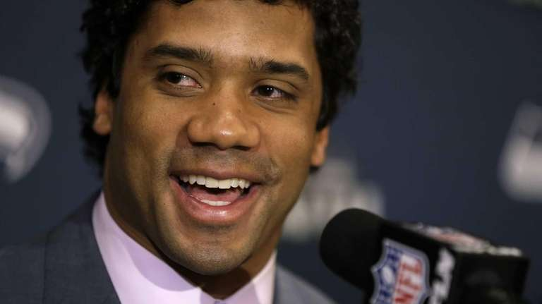 Seattle Seahawks quarterback Russell Wilson speaks during a
