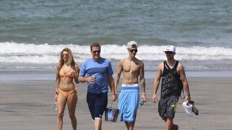 Justin Bieber, second right, and Chantel Jeffries, far