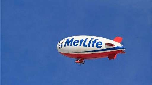 The MetLife blimp flies high over the golf