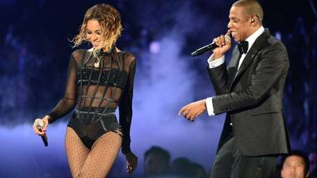 Beyoncé and Jay Z perform on stage at