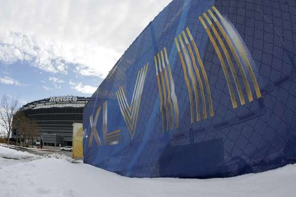 MetLife Stadium rises beyond a patch of snow.