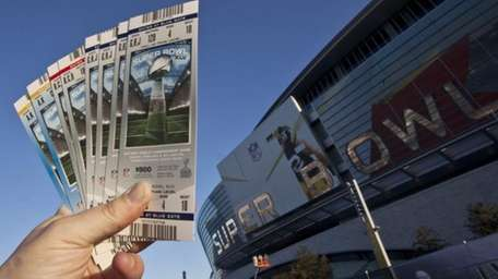 Super Bowl XLV tickets are held outside Cowboys