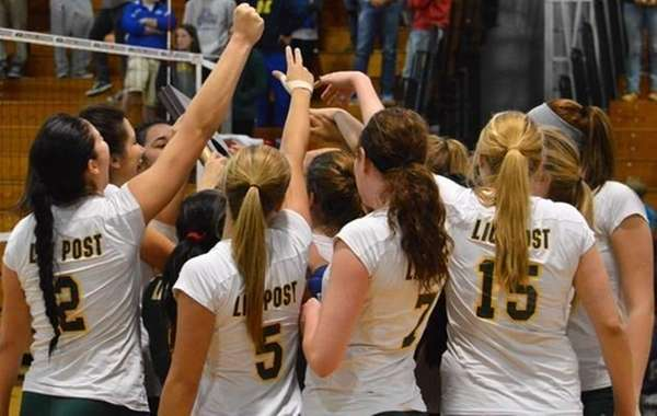 The LIU Post women's volleyball team huddles before