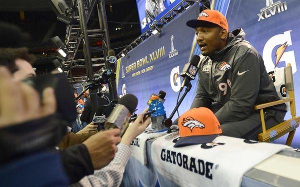 Denver Broncos' Shaun Phillips speaks to the media