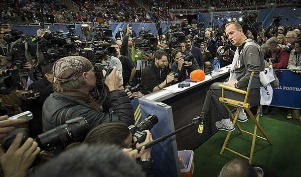 Denver Broncos' Peyton Manning talks with the press