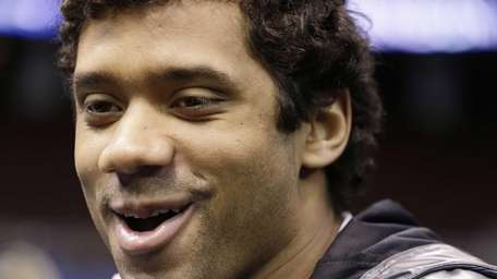 Seattle Seahawks' Russell Wilson answers a question during