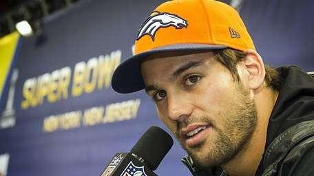 Denver Broncos' Eric Decker talking with the press