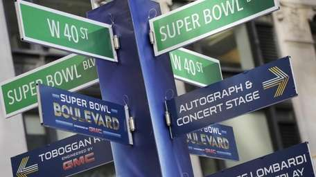 Street signs for Super Bowl Boulevard point to