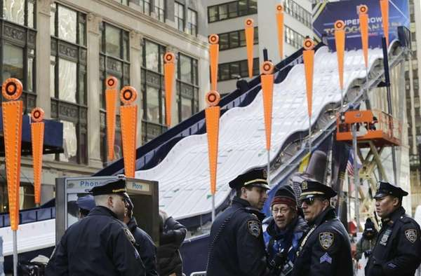 New York City police patrol next to a