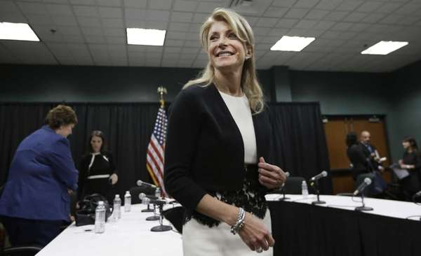 Texas Sen. Wendy Davis smiles as she heads