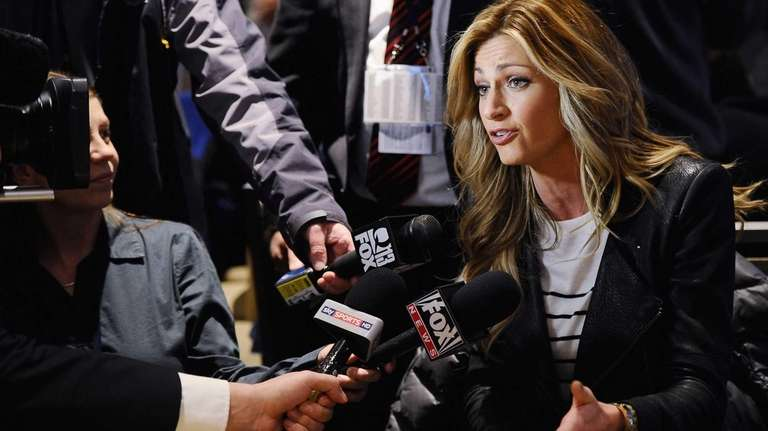Erin Andrews answers questions from the press during