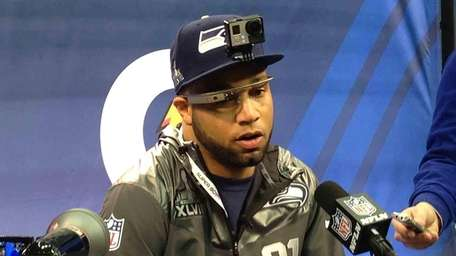 Seattle Seahawks receiver Golden Tate speaks to reporters