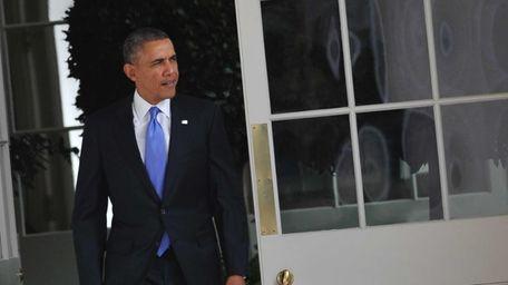 President Barack Obama walks through the Colonnade on