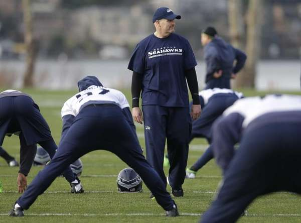 Seahawks defensive coordinator Dan Quinn walks on the