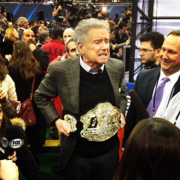 Regis Philbin wears the UFC championship belt.