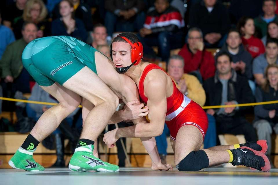 Lindenhurst's Chris Murphy wrestles against Connetquot's Allon Avgi